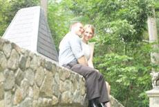 Couple on Rock Wall